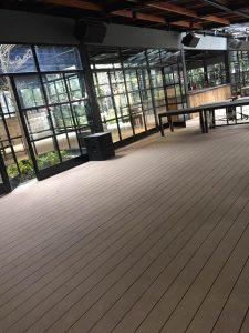 Thi công sàn gỗ nhựa và ốp bồn cây tại The Yard 67 Phó Đức Chính